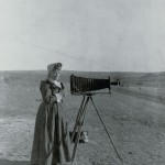 Mrs. A.G. Wallihan with Her Dog and a Camera.