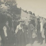 Three Men, Including One Catholic Priest and a Photographer with His Camera, with Three Women in the Streets of an Unknown Pueblo.