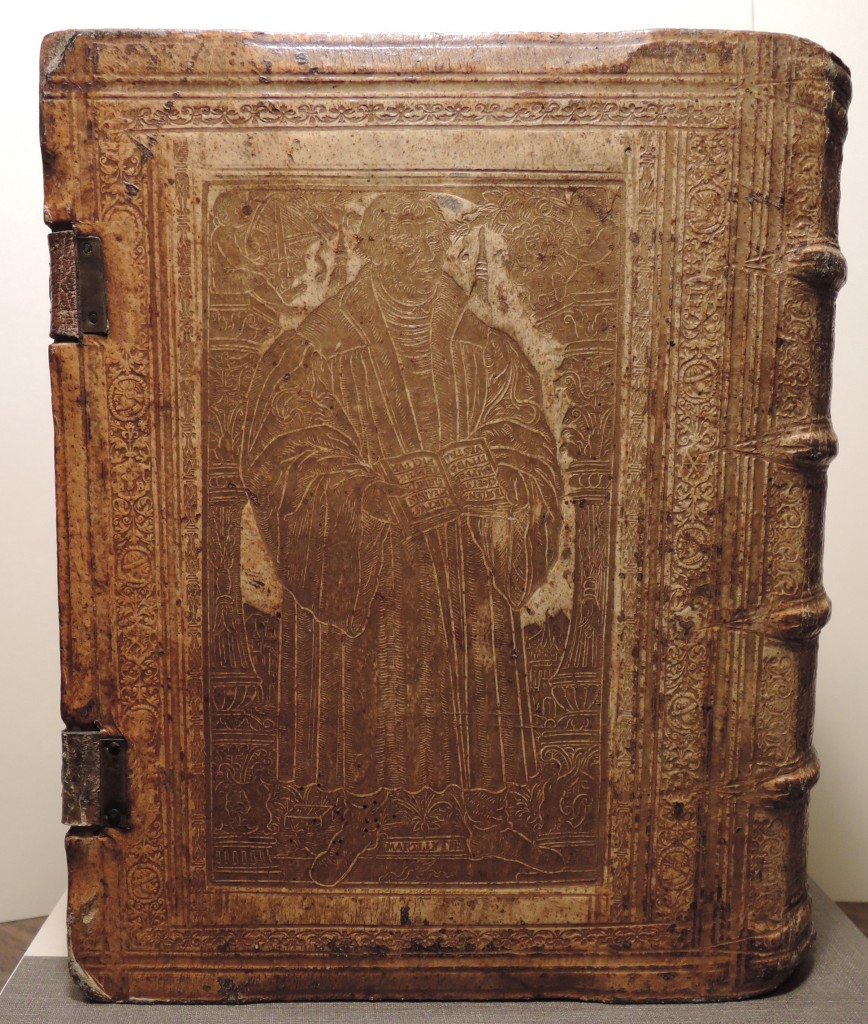 Full length portrait of Martin Luther. Panel signed T.K., that is,  Thomas Krüger, Wittenberg bookbinder. Panel stamped in gilt on back cover of blind-tooled pigskin binding of the first Latin edition of the Lutheran Konkordienbuch (Leipzig, 1580). Call number: Ex 5646.604